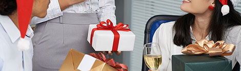 Cropped image of business people exchanging Christmas presents in the office